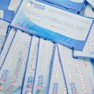 shows a number of clinical guard pregnancy test strips